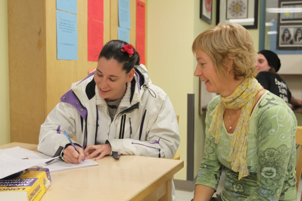 Kryssy Black receiving help with her Creative Writing 12 course from drop-in instructor, Sandy Gillis