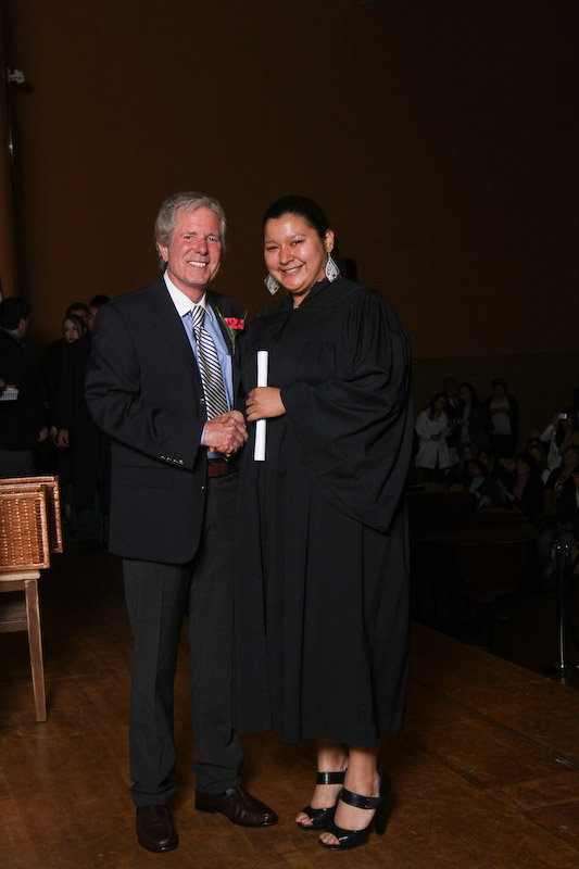 Receiving her diploma from John Crowe, retired Administrator of Adult Ed